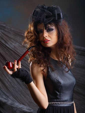 Glamour girl studio portrait , holding pipe