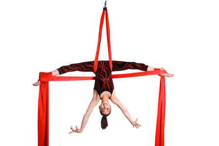 gymnastic girl exercising on red fabric rope, isolated on white background