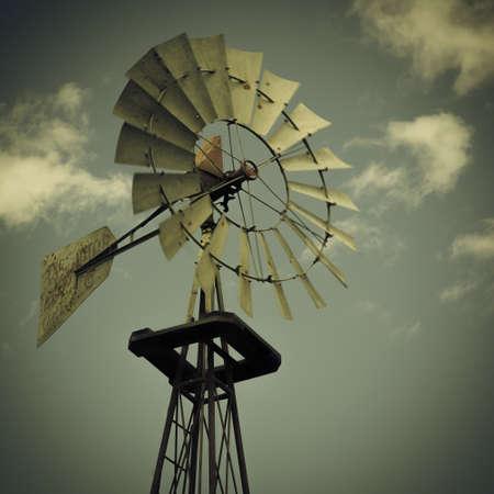 vintage look: Windmill with clouds, vintage look