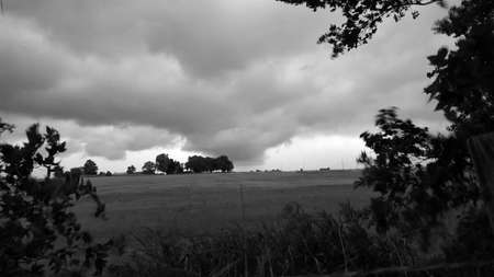 Storm looms over Oklahoma pasture