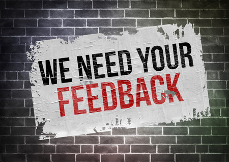 in need: we need your feedback - poster concept Stock Photo