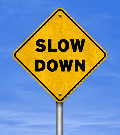 Slow Down - road sign concept