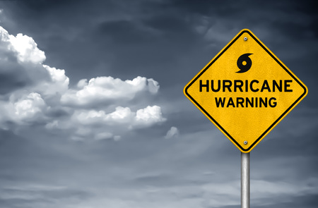 Hurricane warning road sign Imagens
