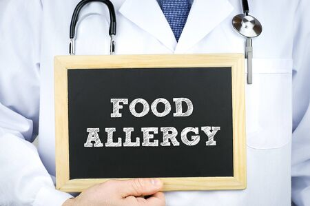 Food Allergy diagnosis message on chalkboard by a doctor