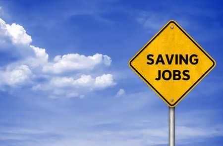 Saving Jobs - road sign message 免版税图像
