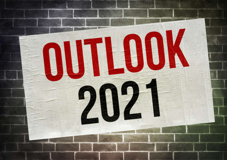 Outlook for 2021 - Message written on a poster 免版税图像