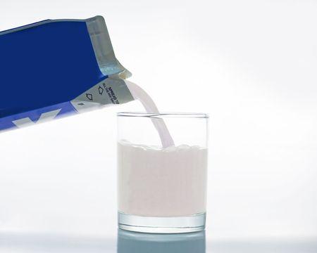 Milk pouring from a carton. Archivio Fotografico