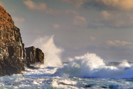 rough sea: Waves breaking on the rocks near the shore. Stock Photo