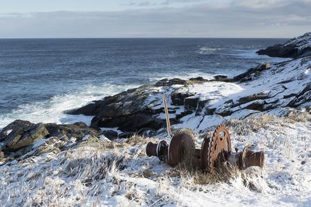 Old winch alone Atlantic coastline in winter