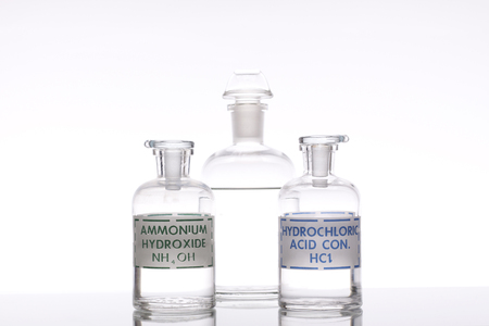 hydroxide: Solutions of ammonium hydroxide and hydrochloric acid. Stock Photo