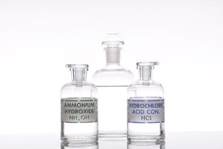 Solutions of ammonium hydroxide and hydrochloric acid. Archivio Fotografico