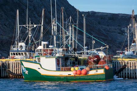 Fishing boats at the dock. Editorial