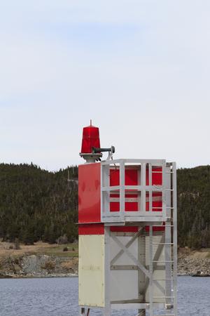 Red coastal navigation marker Imagens