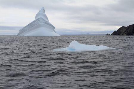 Iceberg along the Newfoundland coastline in summer.