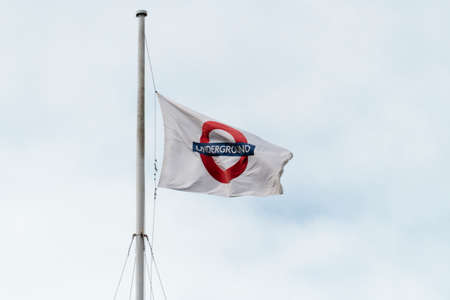 LONDON, UNITED KINGDOM - AUGUST 20, 2017 : The london underground logo flying on flags in London, taken on August 20, 2017 in London. Editorial