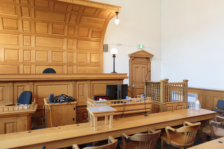 View of a courtroom with judge's chair, lawyers benchs and witness stand