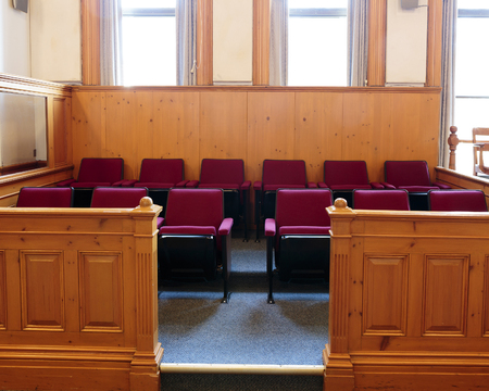 Seats of the jury box in a courtroom