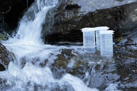 Sampling containers for collecting coliforms and chemicals in water. Stock Photo - 89171395