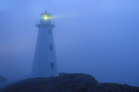 Beautiful historic Lighthouse on the Atlantic Coast in morning fog.