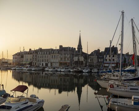 HONFLEUR, FRANCE - MAY 20, 2018. Pleasure and fishing boats in Honfleur Harbour in morning light, taken on May 20, 2018, in Honfleur. Editoriali