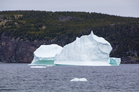 Large 10,000 year old iceberg drifting along the Newfoundland coastline in summer. Stock Photo - 103928007