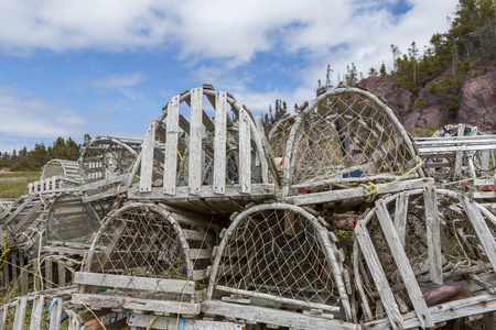 Old abandoned lobster pot used in the commercial fishery and popular with tourist photographers. 版權商用圖片