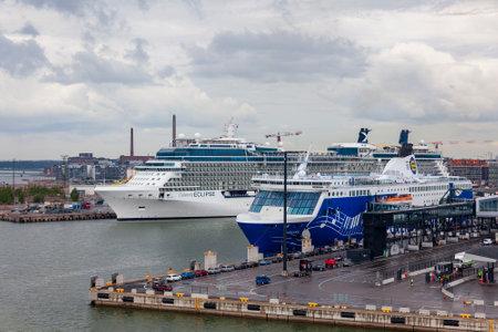 HELSINKI, FINLAND – JULY 5, 2018: Ships moored prior to departing the port of Helsinki, taken on July 5 in Helsinki.