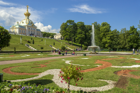 ST. PETERSBURG, RUSSIA - JULY 4, 2018: The grounds of the Peterhof Palace, UNESCO world heritage site, with fountains and gardens, taken on July 4 in St. Petersburg.