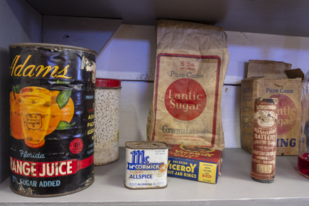 WINTERTON, CANADA, SEPTEMBER 1, 2018: Vintage food and medicine bottles, cans and paper packaging material sitting on a store shelf, taken on September 1 in Winterton.