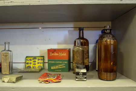 WINTERTON, CANADA, SEPTEMBER 1, 2018: Vintage food and medicine bottles and cans sitting on a store shelf, taken on September 1 in Winterton. Editorial