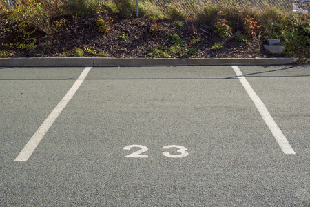 White lines and number for a car parking spot.