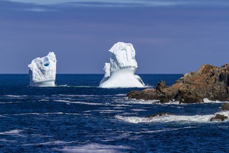 An iceberg along the Newfoundland coastline in summer, very popular with tourist.