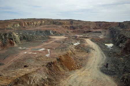 Open pit mining quarry container rocks and water. 版權商用圖片