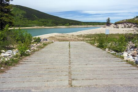 A boat slipway is impacted by changing water levels, British Columbia, Canada.