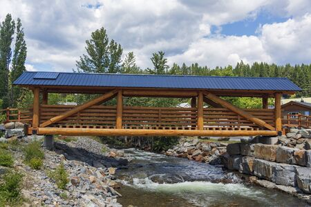 A covered wooden bridge over an alpine river, British Columbia, Canada.