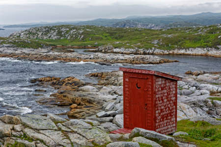 Traditional  red outhouse used in Newfoundland and Labrador.