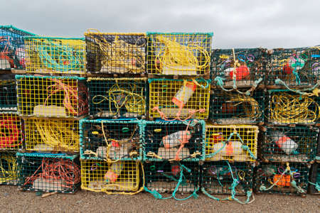 Stacks of lobster pots (traps) at the end of the fishing season, Newfoundland and Labrador, Canada.
