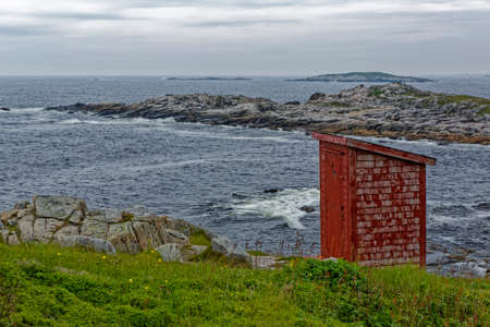 Traditional  red outhouse used in Newfoundland and Labrador, Canada.