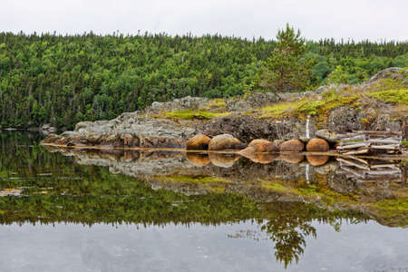 Tranquil Newfoundland and Labrador coastline on a cloudy day.