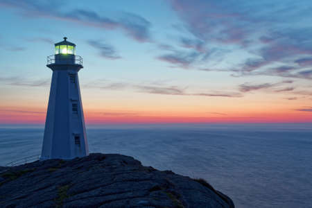 Beautiful historic Cape Spear Lighthouse on the Atlantic Coast at sunrise.