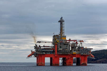 Deep water drill rig is moored near shore after finishing an exploration well, Newfoundland and Labrador, Canada.