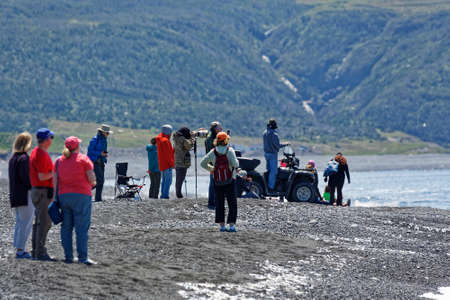ST. VINCENT'S, NEWFOUNDLAND AND LABRADOR, CANADA - July 8, 2020.  People watching the caplin rolling at the beach, taken on July 8, 2020, in St. Vincent's.