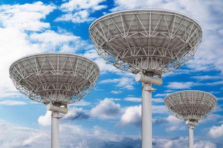 airwaves: satellite dish antennas under the blue sky