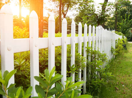 residential neighborhood: County style wooden fence.