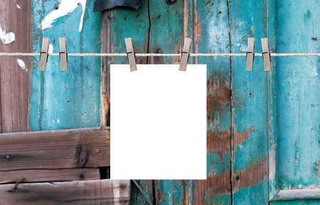 clothesline: on the clothesline. On old wood background. Stock Photo