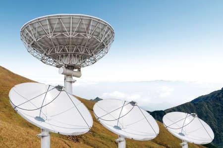 antennas: satellite dish antennas under sky Stock Photo