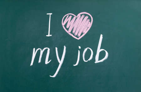 I love my job handwritten with white chalk on a blackboard. Reklamní fotografie - 41361755