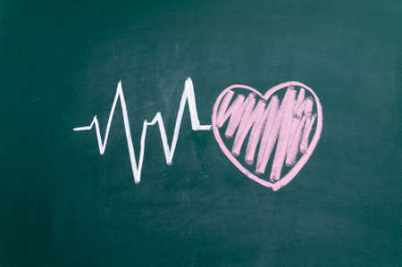 Heartbeat character and design, love heart on a chalkboard photo