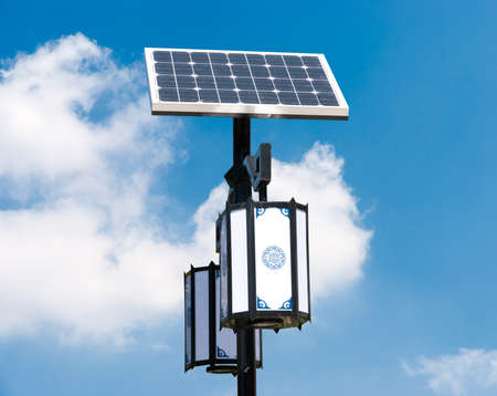 Solar photovoltaic powered lamp posts on the blue skies with sun Reklamní fotografie