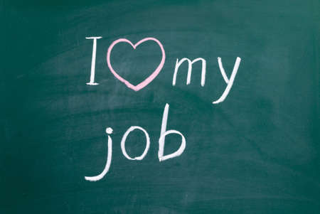 I love my job handwritten with white chalk on a blackboard. Reklamní fotografie